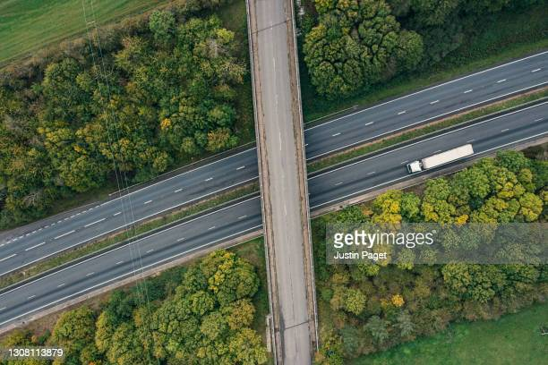 drone point of view of an articulated lorry on a major road - elevated view stock pictures, royalty-free photos & images