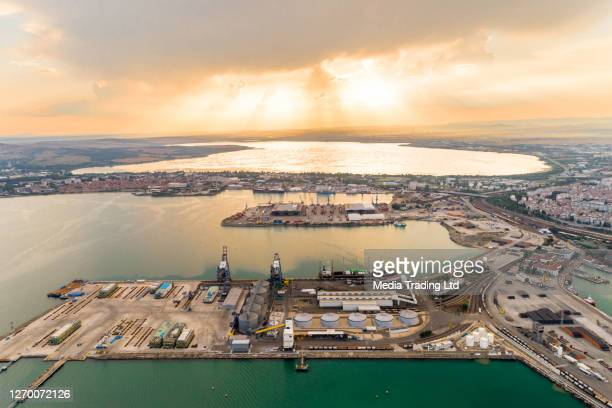 drone point of view of burgas harbor during sunset - (bulgarian: пристанище бургас, българия) - bulgaria stock pictures, royalty-free photos & images