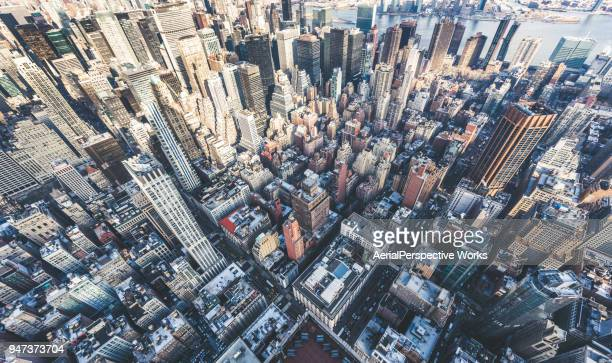 drone point of view of manhattan skyline - new york skyline stock photos and pictures
