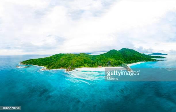 drone point of view of the island la digue, baie gran anse, seychelles. - isla fotografías e imágenes de stock