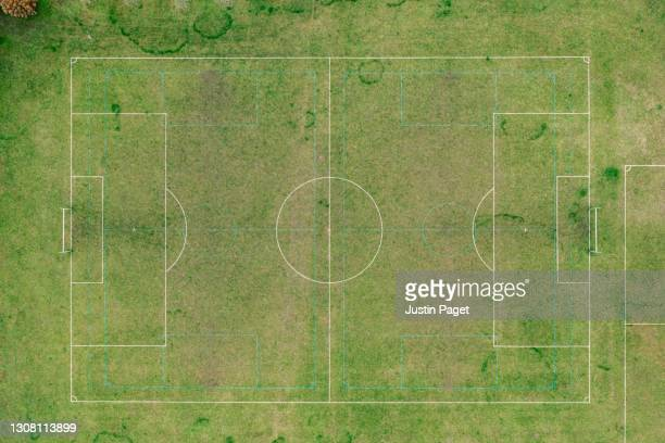 drone point of view over a community grass football pitch - training grounds stock pictures, royalty-free photos & images
