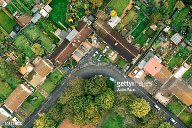 drone point of view over a residential area in the uk - green colour stock pictures, royalty-free photos & images