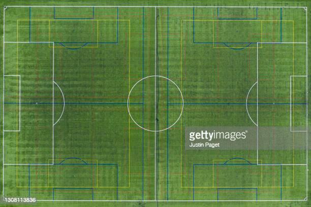 drone point of view over an astroturf football pitch - training grounds stock pictures, royalty-free photos & images