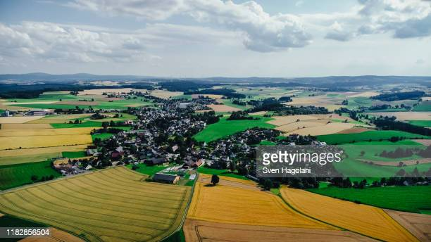 drone point of view sunny view farmland and rural townscape, bayern, germany - bayern stock pictures, royalty-free photos & images