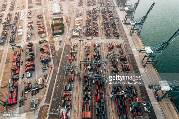 drone point view of busy industrial port with containers ship - tianjin stock pictures, royalty-free photos & images