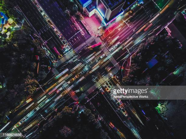 drone point view of city street crossing at rush hour - crossing stock pictures, royalty-free photos & images