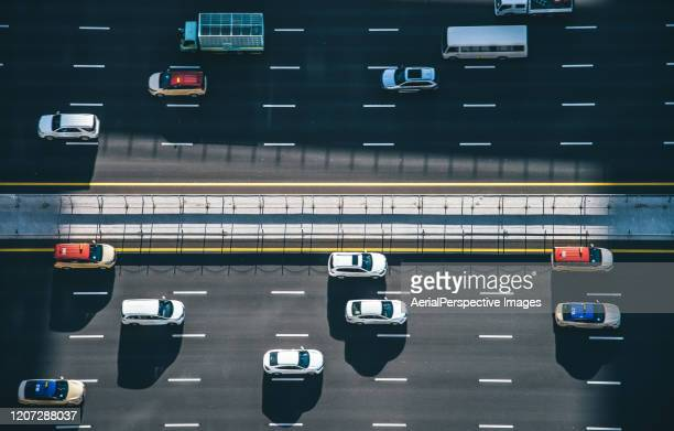 drone point view of dubai city traffic on a highway - traffic stock pictures, royalty-free photos & images