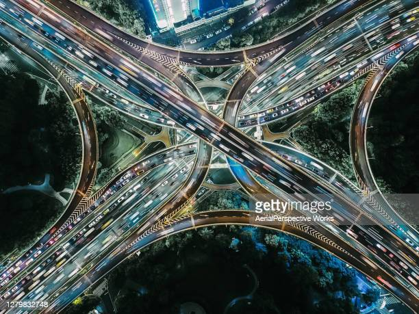 drone point view of overpass and city traffic at night - shanghai stock pictures, royalty-free photos & images