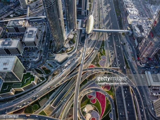 drone point view of road intersection - dubai stock pictures, royalty-free photos & images