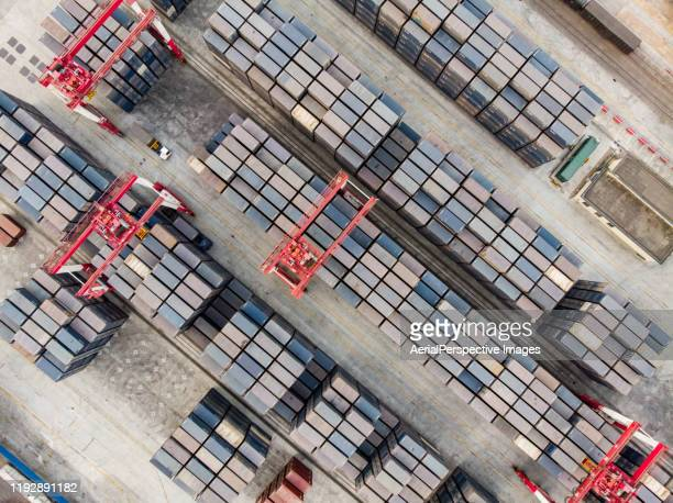 drone point view of rows of shipping containers in port terminal - lagerraum stock-fotos und bilder