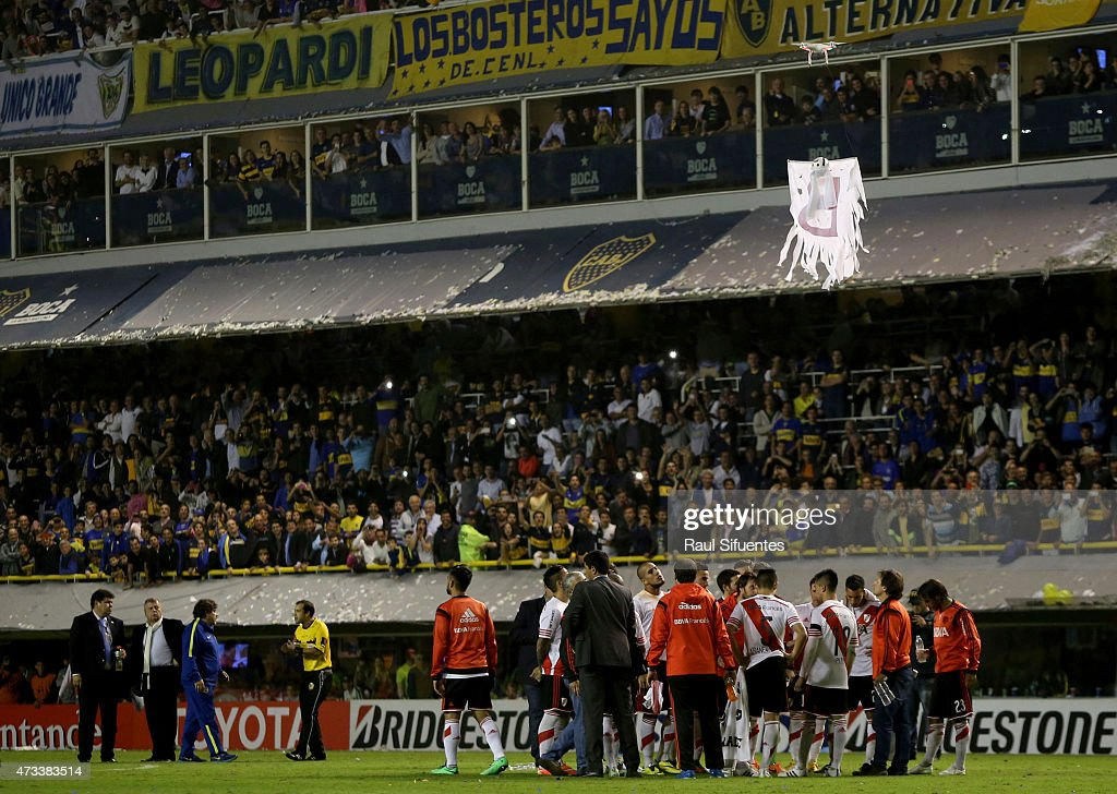 A drone remote-controlledee carrying a cloth simulating a ghost with a letter B on it is seen over the field during a second leg match between Boca Juniors and River Plate as part of round of sixteen of Copa Bridgestone Libertadores 2015 at Alberto J. Armando Stadium on May 14, 2015 in Buenos Aires, Argentina.