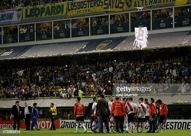 A drone remotecontrolledee carrying a cloth simulating a ghost with a letter B on it is seen over the field during a second leg match between Boca...