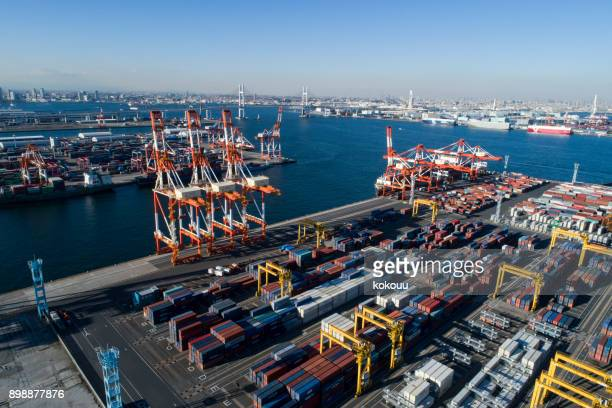 drone shooting. harbor, overhead view, sea. cargo crane. - freeport bahamas stock photos and pictures