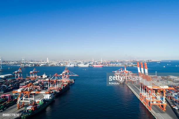 drone shooting. harbor, overhead view, sea. cargo crane. - grand bahama stock photos and pictures