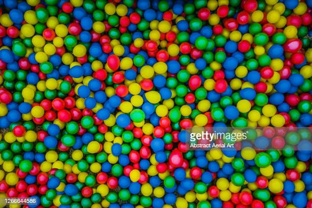 drone shot directly above thousands of multicoloured balloons, wolverhampton, united kingdom - playing stock pictures, royalty-free photos & images