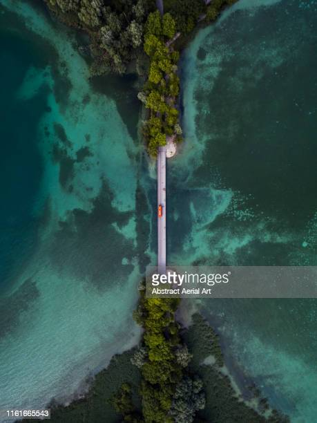 drone shot looking down on a bridge crossing over lake konstanz, bavaria, germany - puente fotografías e imágenes de stock