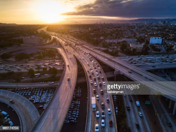 drone shot of 10/110 interchange at sunset - traffico foto e immagini stock