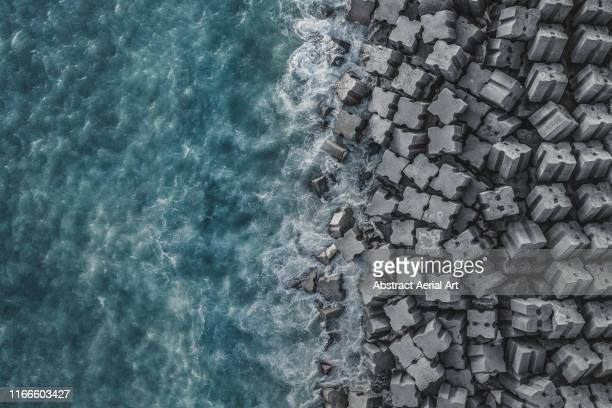 drone shot of a costal defence, liguria, italy - defending stock pictures, royalty-free photos & images
