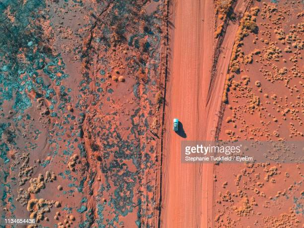 drone shot of car moving on landscape - drone point of view stock pictures, royalty-free photos & images