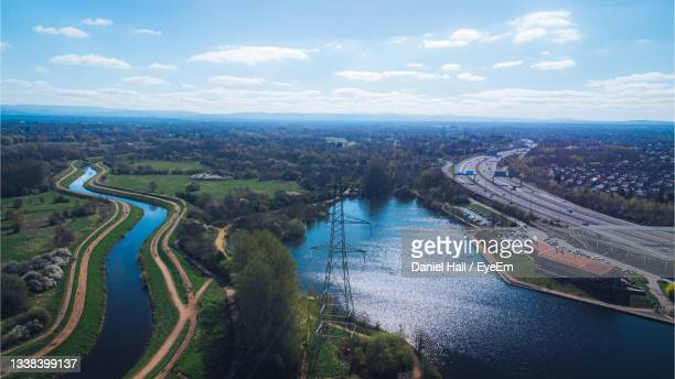 a drone shot of sale water park and the river mersey, manchester, uk - northwest england stock pictures, royalty-free photos & images