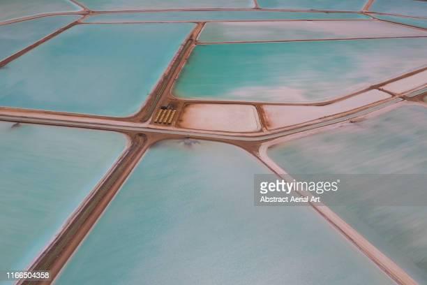 drone shot of salt evaporation ponds, useless loop, australia - questão ambiental imagens e fotografias de stock