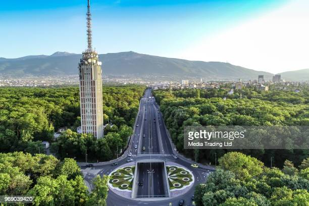 drone shot of traffic circle and radio tower in the middle of a beautiful city forest - bulgaria stock pictures, royalty-free photos & images