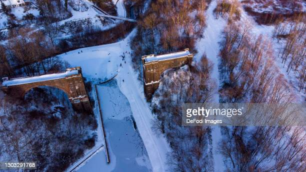 Drone shot over a former bridge in the Phoenix West district in snow on February 11, 2021 in Dortmund, Germany.