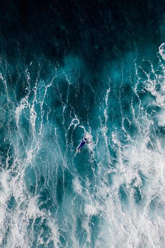 Drone shot over ocean and single surfer, Lanzarote - gettyimageskorea
