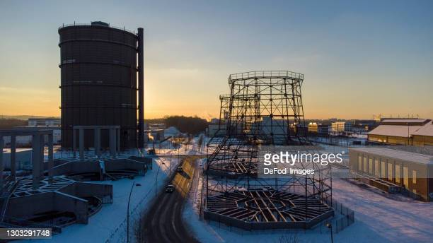 Drone shot over the dump Entenpoth with the gasometer and the scaffolding of the former blast furnaces in the Phoenix West district in snow on...