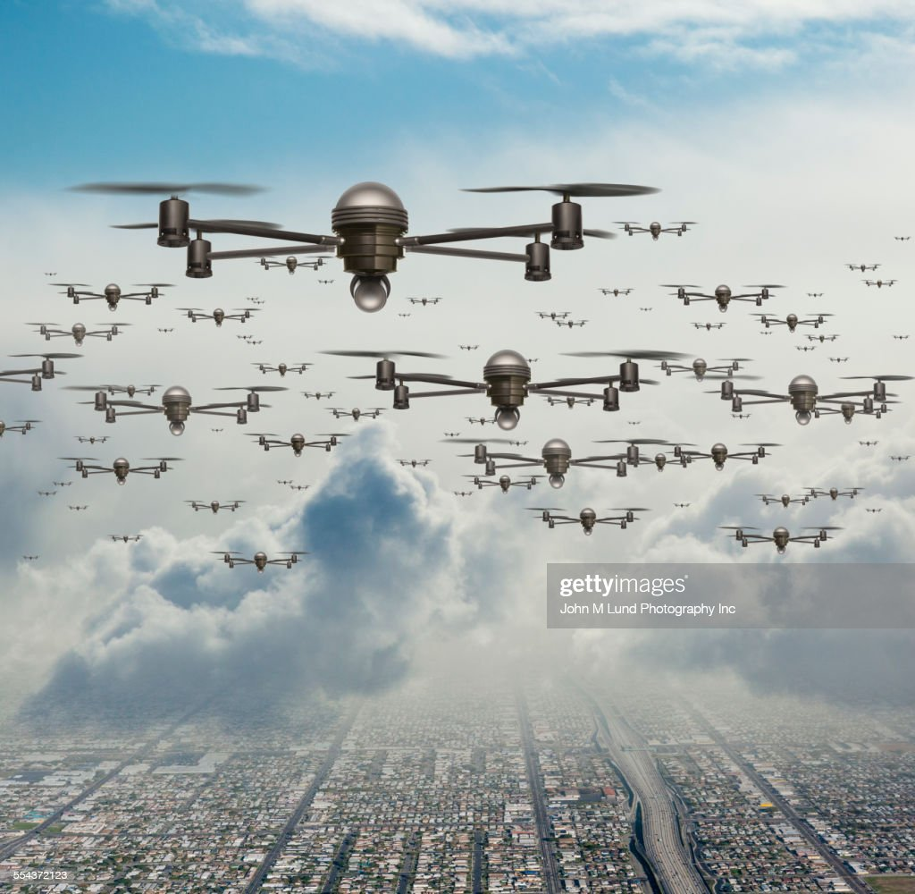 Drone Surveillance Planes Flying Over City Stock Photo