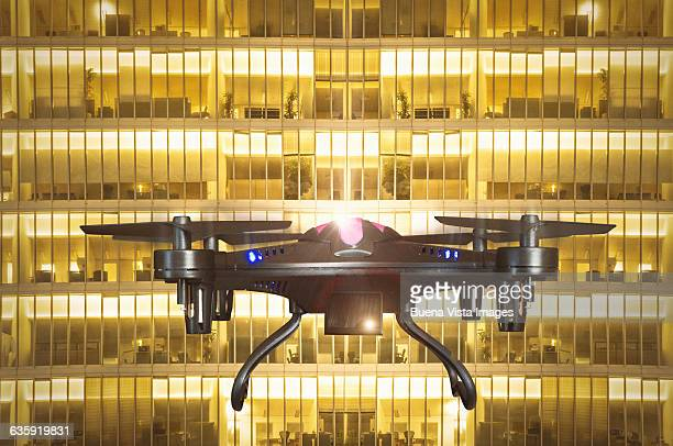 a drone surveying offices in a building - big brother orwellian concept stock pictures, royalty-free photos & images