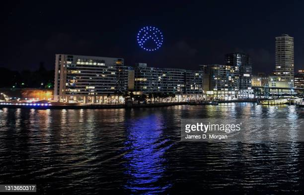 Drone swarm illustrating the Xbox logo appears over East Circular Quay on April 21, 2021 in Sydney, Australia. The light show featuring 50 drones is...
