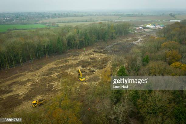 Drone view of a cleared strip of land along the HS2 route that cuts through Cubbington Woods on November 30, 2020 in Leamington Spa, England. The...