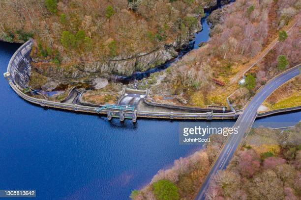 drone view of a hydro electric dam in scotland - johnfscott stock pictures, royalty-free photos & images