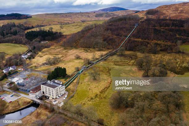 drone view of a hydro electric power station - johnfscott stock pictures, royalty-free photos & images