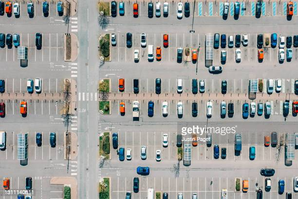 drone view of a retail outlet car park - drone stock pictures, royalty-free photos & images