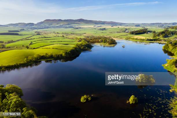 drone view of a scottish loch on a calm spring morning - johnfscott stock pictures, royalty-free photos & images