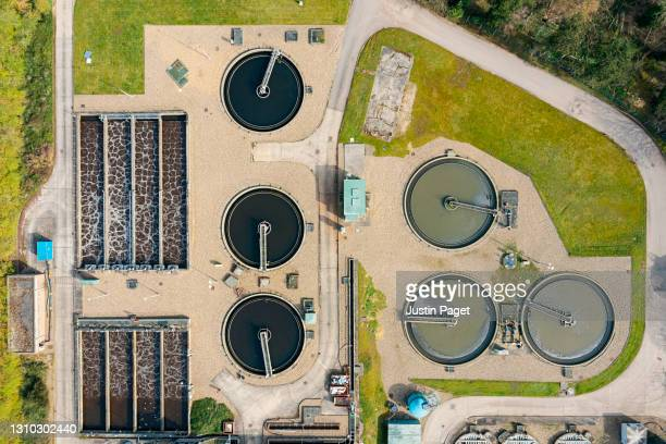 drone view of a sewage treatment plant - industry stock pictures, royalty-free photos & images