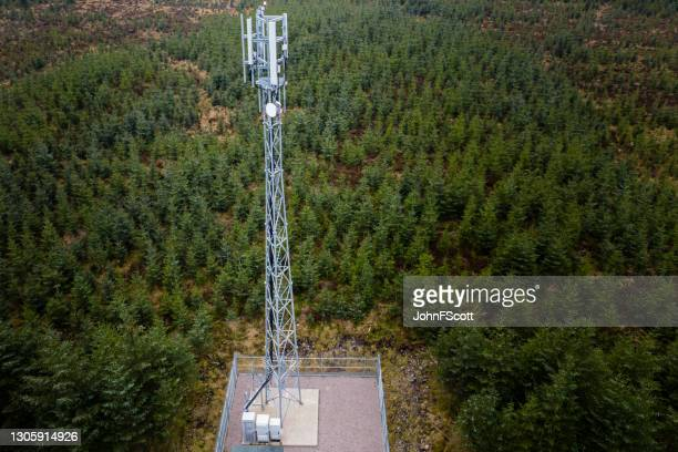 drone view of a telecom mast in a rural location - johnfscott stock pictures, royalty-free photos & images