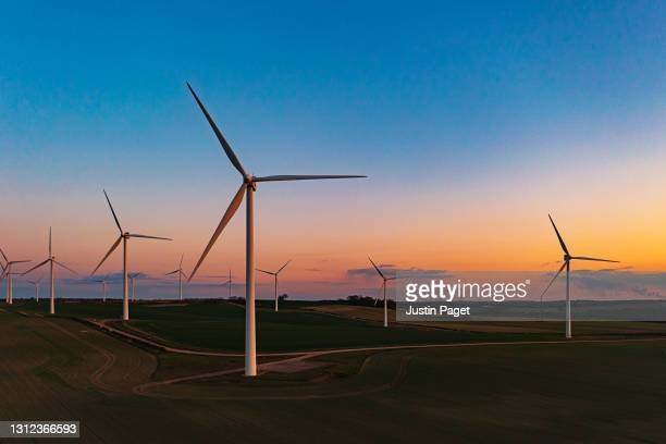 drone view of a wind farm. multiple wind turbines - landscape scenery stock pictures, royalty-free photos & images