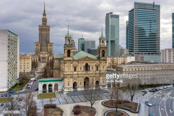 drone view of all saints' church at grzybowski square - holocaust stock pictures, royalty-free photos & images