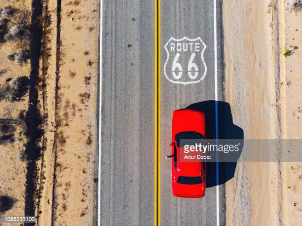 drone view of american car driving in a straight road of the famous route 66. - route 66 photos et images de collection