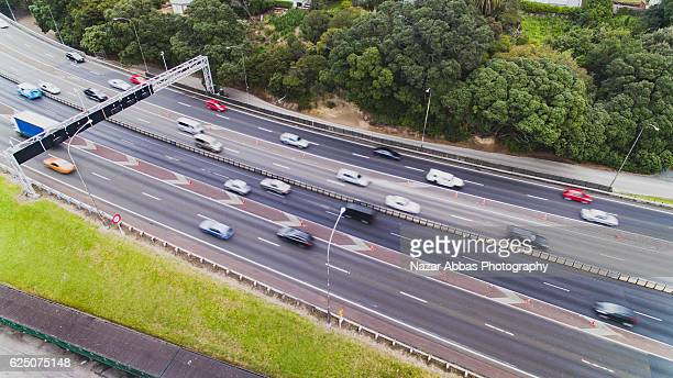 Drone view of Auckland Traffic on a busy road.