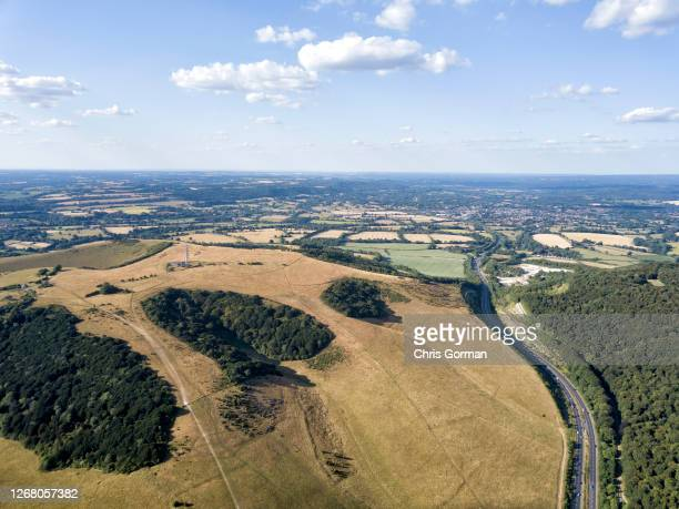 Drone view of Butser Hill in The South Downs National Park with Petersfield and the A3 in view on July 8,2018 in England.