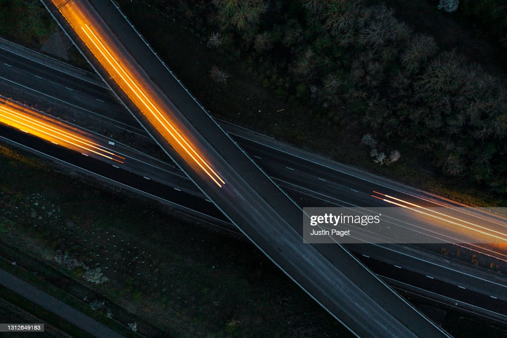 Drone view of cars moving in different directions at night : Stock Photo