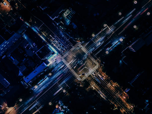 Drone View of City Street Crossing at Night