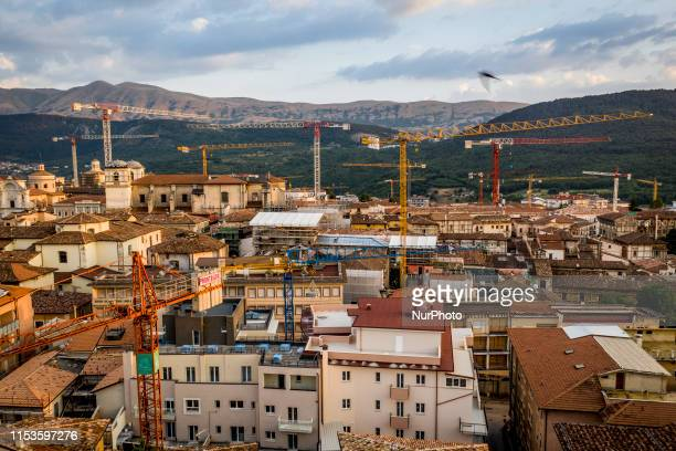 A drone view of cranes in downtown of L'Aquila Italy on July 4 2019 An earthquake of 58 on the Richter magnitude scale hit L'Aquila and surrounding...