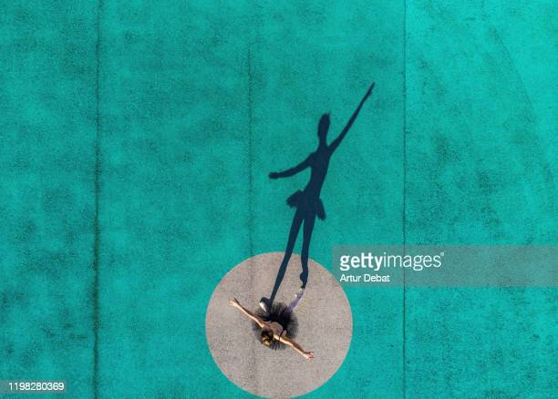 drone view of creative picture of ballerina stands out from circle with color. - drone point of view stock pictures, royalty-free photos & images