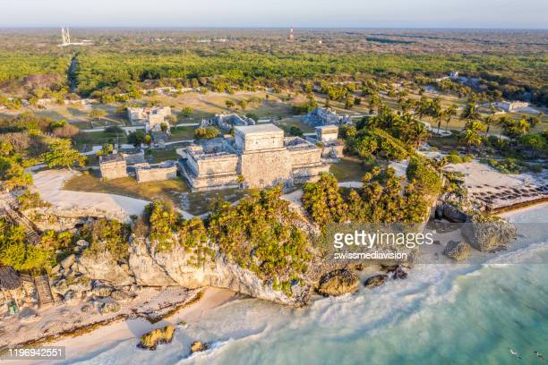 drone view of el castillo, tulum ruins archeological zone, mexico - cancun stock pictures, royalty-free photos & images