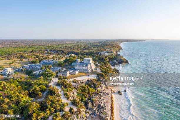drone view of el castillo, tulum ruins archeological zone, mexico - quintana roo stock pictures, royalty-free photos & images